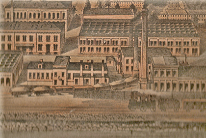 Part of Jönköpings Tändsticksfabrik AB in the 1870s. The single-story building in the foreground is now the matchstick museum. Lithograph.