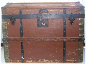Wooden trunk with reinforcements of sheet iron and brass-plated sheet iron.