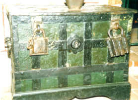 Money chest for the collection in the Mariekirche in Lubeck, Germany. 16th century, with two padlocks from the same period and lock bolts built into the lid that were controlled with the key from the front.