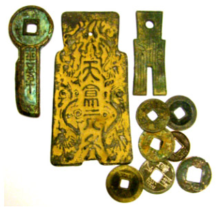 Antique Chinese bronze coins: Key coin, spade coins (2) and cash coins. Photo by the author.